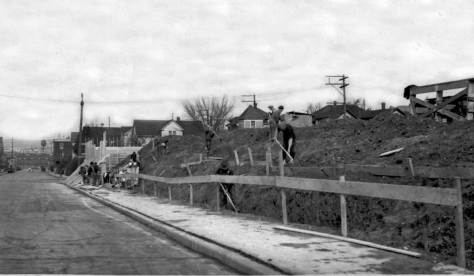Same wall along the east side of Minor Ave. between Thomas and Repubican Streets during its depression-time 1930s construction for the Cascade Playfield (to service, in part, the children of Cascade School, which was directly to the east across Pontinus Avenue.)