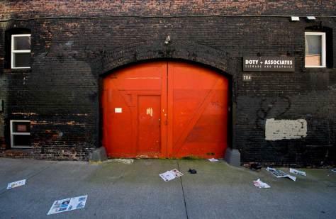 black-wall-red-door