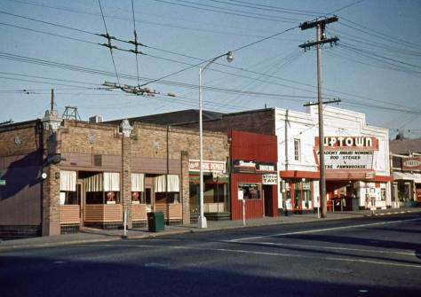 Looking northwest through the intersection of Thomas Street and Queen Ave. to the Uptown Theatre on March 24, 1966.