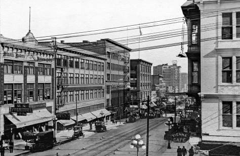 THEN: Looking south from Pine Street down the wide Second Avenue in 1911, then Seattle's growing retail strip and parade promenade. (courtesy of Jim Westall)