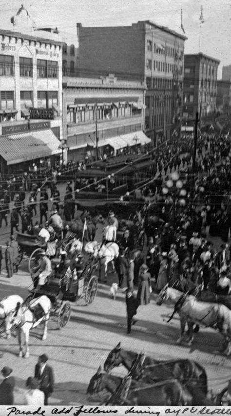 "From nearly the same window, looking south on Second Avenue from its northwest corner with Pine Street and from an upper floor at Standard Furniture, Philip Hughett captioned this view ""the odd fellow's parade."""