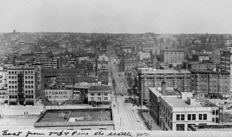 Recently we printed a cropped version of this for another now-then feature - one describing the fate of Seattle Electric's trolley car barns at 5th and Pine.  The view looks east on Pine.  The outline of the nearly new Volunteer standpipe appears on the left horizon.