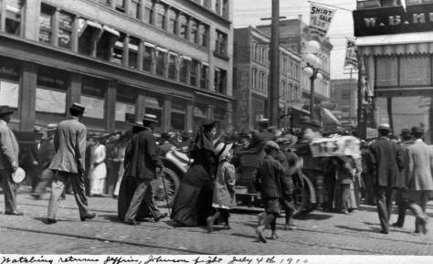 """On the same afternoon as the Independence Day parade a crowd gathered on Union Street - clogged it - beside The Times building to follow the wire reports on James J.Jeffries vs. Jack Johnson """"fight of the century"""" in Reno.  Jeffries, a former world champion, came out of retirement, he said, """"to demonstrate that the white man is king of them all.""""  Rather than be knocked out, Jeffries withdrew in the 15th round and Johnson held on to his heavyweight campion status.  With the ambitions of the """"great white hope"""" dashed riots followed.  By the following morning 25 blacks and 3 whites had died because of them."""