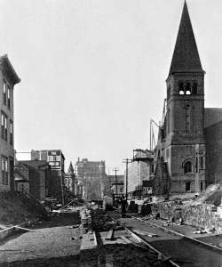 THEN: Looking north from Seneca Street on Third Avenue during its regrade in 1906. (Photo by Lewis Whittelsey, Courtesy of Lawton Gowey)