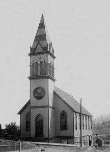 THEN: Built in 1888-89 at the northeast corner of Fourth Avenue and Pine Street, the then named Norwegian-Danish Evangelical Lutheran Church marked the southeast corner of Denny Hill. Eventually the lower land to the east of the church (here behind it) would be filled, in part, with hill dirt scraped and eroded from North Seattle lots to the north and west of this corner. (Courtesy, Denny Park Lutheran Church)