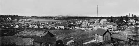 Green Lake panorama - and not complete.  A third part, far right, of Wallingford is not included.  This looks west across the lake to Phinney Ridge in 1903 and so a few years before the lake was lowered and this east bay of the lake was largely filled in for a recreation field and field house.  Today, Interstate-5 crosses directly in front of this scene. (Courtesy Washington State Museum, Tacoma.  Photo by A. Curtis.)