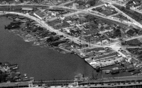 Another aerial of the neighborhood - perhaps from the same flight as that penultimate to this.  Note that the University Bridge at the bottom is two bridges.  The small two lane span was built for temporary service during the years that the wooden pilings of the original bridge's approaches were replaced in 1932-33 with the concrete pilings that still support it - we believe.