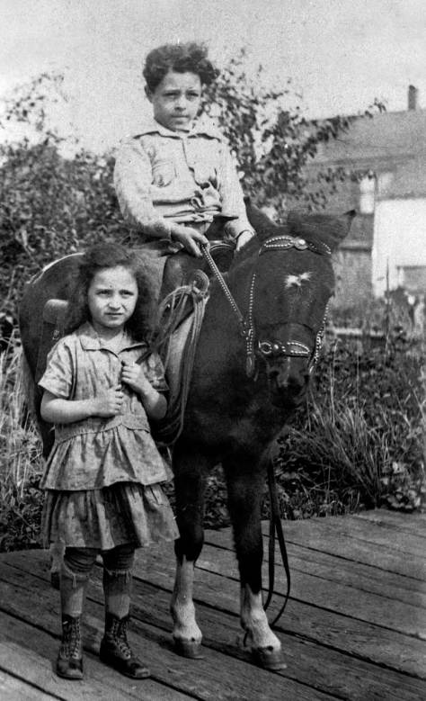 Boy-on-horse-posing-with-girl-WEB