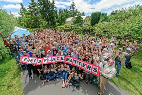 """NOW: The """"This Place Matters"""" enthusiasm of June 1, last, is wonderfully captured with Jean Sherrard's big lens.  He is not of course as close to the Mukai farm house and garden as is the """"then,"""" because of the fence."""