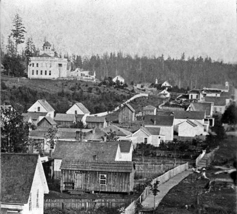 Another look at the University on Denny Knoll, ca. 1874.  Third Avenue with a fairly new sidewalk is bottom-right.  The horizon shows a still forested Beacon Hill.