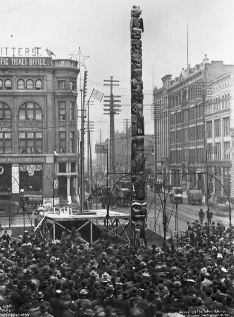 "The ""Stolen Totem"" at its 1899 Pioneer Place dedication.  A. Wilse took the photo, and the Seattle Good Willl Committee while on its cruise to and back from Alaska during the gold rush, took the totem pole off of Tongass Island."
