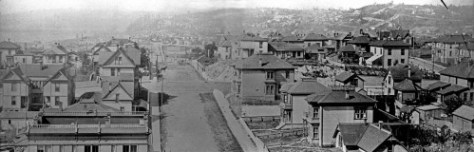 Looking north on 3rd from the rear of the Denny/Washington Hotel.  This pan is made from two negatives that while not perfectly fit make together a very rare and impressive look at the neighborhood established ca. 1903 on top of Denny Hill.  The photograph shows the back summit of the hill, but was photographed from the hotel on the slightly lower front (southern) summit.  Virginia Street if out of frame and below the pan.