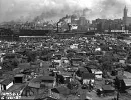 For comparison another look at Hooverville from the roof of the rubber products company.  This one is date June 10, 1937. (Courtesy Municipal Archive)