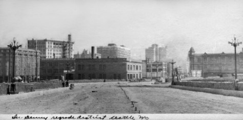 Looking south on 3rd Ave. with the photographer's back to Lenora Street.  Third is being prepared here for brick paving.  At the center is the new Fire Station. This looks back thru the foreground of the 3rd Ave. subject printed directly above this one.  This dates from ca. 1910.