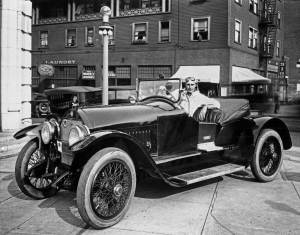 THEN: While visiting Seattle for some promoting, silent film star Wallace Reid shares the sidewalk at 4th and Olive with a borrowed Stutz Bearcat.  (Courtesy, Museum of History & Industry)
