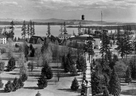 Some few years after the 1909 AYP, looking southeast from Denny's Hall's cupola in line with its sidewalk to the first location the pioneer Columns were shown when they were first moved to the new campus from the old about the time of AYP.   The Forestry Building can be found to the right of the water tower, which breaks the far horizon of Cougar Mountain and so very near Hillside School where Jean teaches drama and writing - and much else.