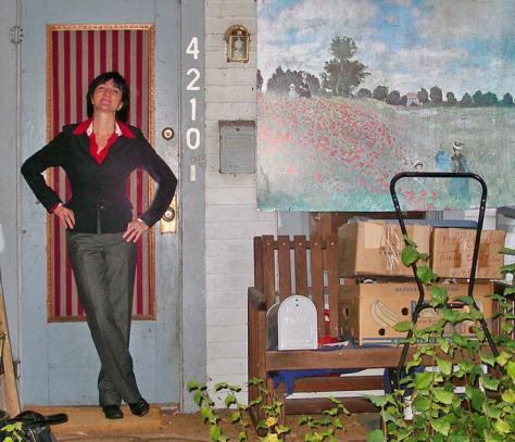 Charter Curator  Berangere Lomont at the front door of the Forsaken Art House, ca. 2010, and future home of the Forsaken Art Museum ca. 2014