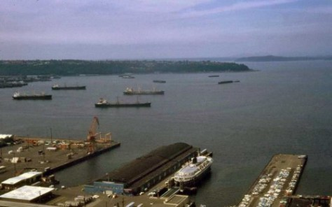 Lawton Gowey's recording from Aug. 27 1971.  The Port of Seattle's early parking for containers is far left, and an Alaskan Ferry is parked along the north side of its terminus then, Pier 48.