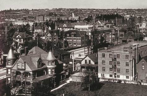Below a Capitol Hill horizon(along 15th Ave.), Broadway High School, the Lincoln Park Reservoir fountain, in the foreground a small circle of big First Hill homes forms to the sides of Madision Ave., on the far left, with the Ranke home bottom-left.  Behind the Rankes are - still - the Hanfords and at the northeast corner of Boren and Madison, the Stacy Mansion, soon and still the University Club and, far-right at the southeast corner of Madison and Boren, the Carkeek Mansion.