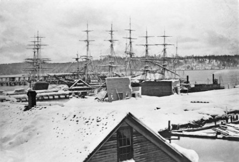 Yesler's Wharf during the Big Snow of 1880 (the very biggest ever) with damaged sheds and a West Seattle horizon. (Courtesy, Greg Lang)