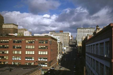 Most likely Robert Bradley took this look east on Madison from the Alaskan Way Viaduct before it was opened to traffic in the spring of 1953.  Here, as well, no poplars are showing above Madison's distant horizon.