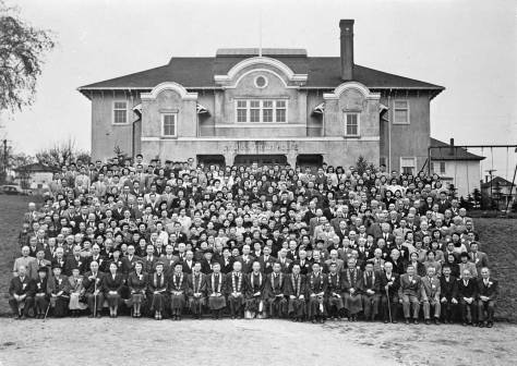 The COLLINS PARK FIELD HOUSE opened in 1913 and closed in 1971.  Here members of the Japanese American Association pose beside it in the 1930s.  (Courtesy, Seattle's Japanese Buddhist Temple)