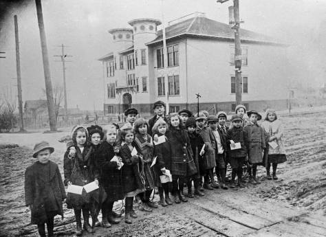 Another  - that is, not the one directly below - group of Latona School kids pose with their school and their report cards.