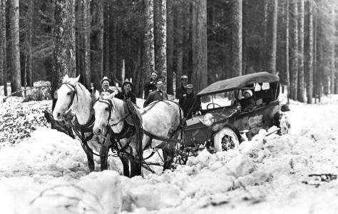 A motorcar saved by horses.  This, I believe, is a popular MOHAI print and the subject is somewhere on the road to Stevens Pass still years before it reached the pass.