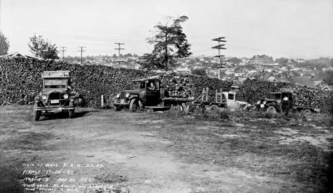THEN: An Emergency Relief Administration wood pile took temporary quarters on the southeast corner of S. Alaska Street and 32nd Ave. S. in 1934. (Courtesy, Northwest Collection, University of Washington Libraries.)