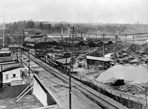 Like the subject directly above, this one also looks west on Andover, but also down on it form the neighborhood hotel.  The view is date 1919, and by then Pacific Coast Steel's Seattle plant was operating four open hearth furnaces.  It was easily the largest steel-making facility in the Pacific Northwest. [Courtesy, MOHAI]