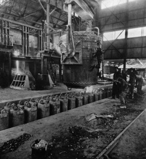 Ingots - all in a row - are here top cased in the open hearth pit, which was first opened soon after Pacific Steel too over Seattle Steel in 1911. [Courtesy, MOHAI]
