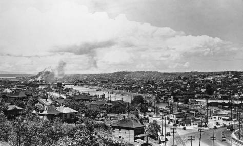 Another look west along the completed canal with the 8th Ave. railroad bridge showing on the left and Ballard beyond it. (Courtesy, MOHAI)
