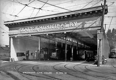 The Fremont Car Barn on Sept. 23, 1919.  Over the bays the private company name has been replaced with the public name.  (Courtesy, Seattle Municipal Archive)