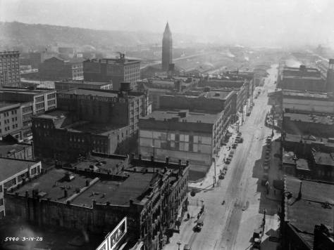 From a higher floor in the Smith Tower, Second Avenue shows its first signs - with the bared wall at the center - of its being extended through the neighborhood.  The Municipal Archive negative is date, bottom-left, March 14, 1928.