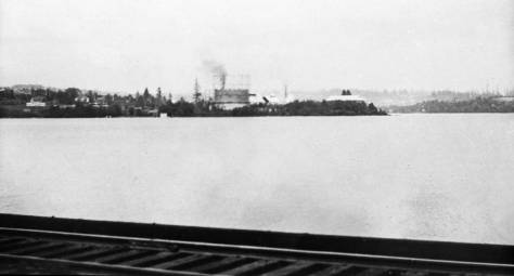 "Another from the Gas Company albums.  This looks east from the trolley bridge to the Wallingford peninsula with its ""fresh"" Gasworks still under construction in 1907."