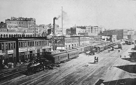 Another 1890s look down on Railroad Avenue north from the Madison Street coal trestle.  The several afternoon shadows of the short pier sheds along the waterfront then appear on the right.