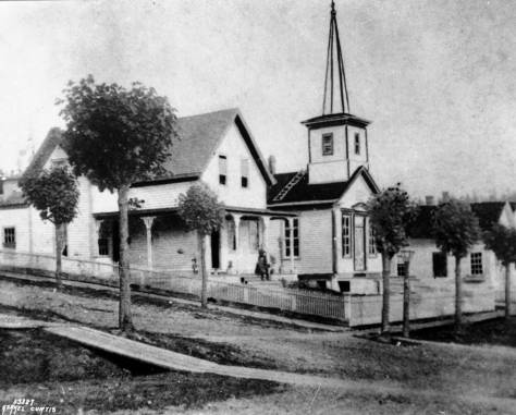 "Seattle's first church the ""White Church"" and the Methodist Episcopalian parish home to this side of it on the southeast corner of Second Avenue and Columbia in the 1870s."