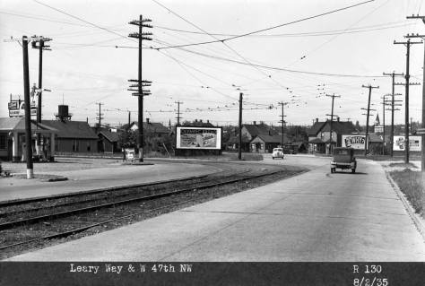 Looking northwest to the Leary Way curve between N.W. 47th Street and 11th Ave. N.W..  Again, the photograph's own caption is preoccupied with its billboard.