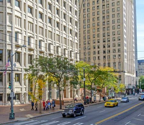 NOW: The entire block bordered by First and Second Avenues and Marion and Madison Streets was cleared in the late 1960s for the construction of architect Fred Bassetti's Henry M. Jackson Federal Office Building, which opened in 1974.