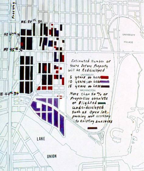 "This keyed map (but not the keys of a computer) speculates on when the empty lots and worn residences in the University District would be developed with what it does not indicated.  But note that the purple blocks, which include our home site, are expected to go first and be ""renewed"" in ten years of the map's drawing, which was about 1963.  The map came to me through Cal, the one-time ""Mayor of the University District."""