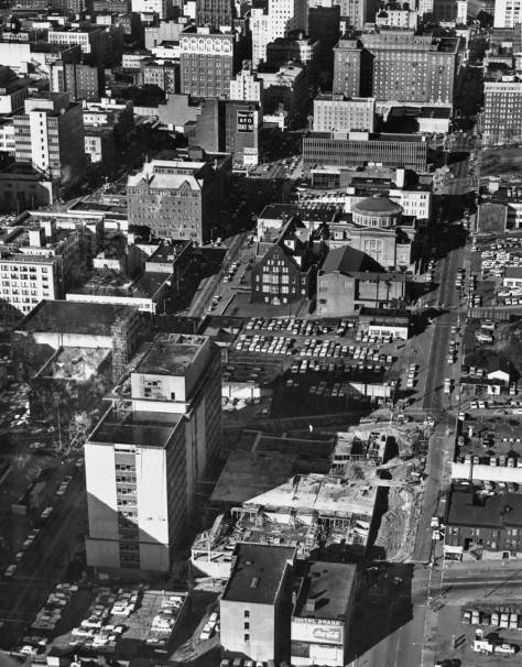 A circa 1960 aerial of the Municipal Building Construction with its parking lot to the rear.