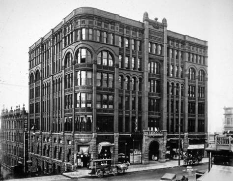 The Burke Building northwest corner of Marion and Second, with a corner of Stetson-Post at the bottom-right corner. A. Wilse photographed this most likely in the late 1890s.  He returned to Norway in 1900.