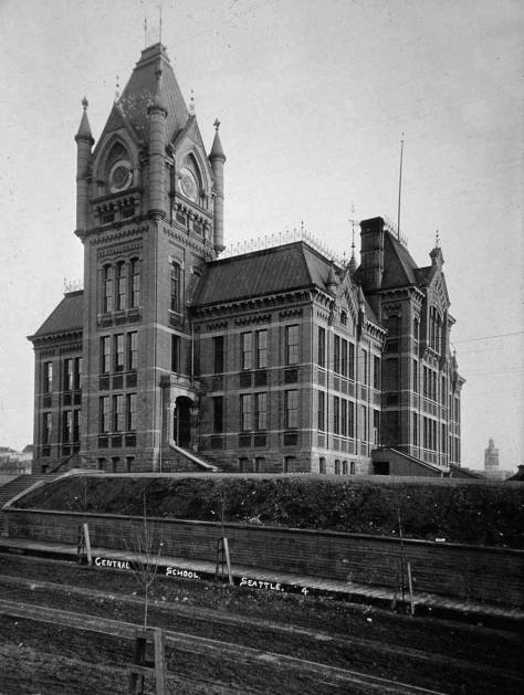 Central School, designed by Boone, seen looking southeast across the intersection of 6th Avenue and Madison Street.