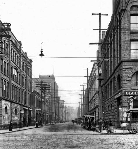 """The Marshall-Walker Block (built 1890-91) on the right at the southeast corner of Main Street and First Avenue South.   Long the home of the Elliott Bay Book Store, Allied Arts, and Jim Faber's office.  Jim wrote """"The Irreverent Guide to Washington State, although he was himself a saint."""