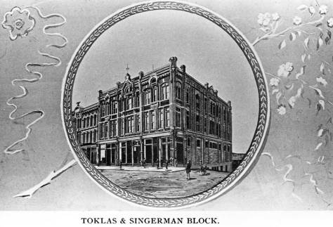The Toklas and Singerman Department store at the southwest corner of Front Street (First Ave.) and Columbia Street, destroyed by the 1889 fire.