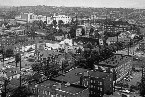 """The increasingly """"Pill Hill"""" part of First Hill photographed from Haborview Hospital in 1956, the year Bertha Gardner died.   The Gardner home appears here directly below the large and dark three story (or four) apartment, upper-right.   Her physician husband's death precede Bertha's by many decades.  By 1956 she had moved to the University District."""
