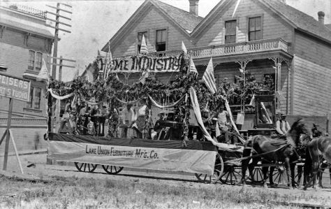 "The south facade of Stetson-Post appears on the left in this late-1880s parade scene photographed from Peiser's ""Art Studio."""