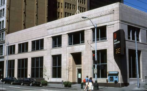 The First Interstate Bank was the last occupant of the corner, serving from a modern remodel of the ornate tile cover.  Lawton Gowey took this on July 26, 1981.