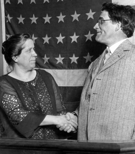 Bertha Landes shaking hand of Mayor Ed.Brown whom she defeat in the 1926 mayoral election.