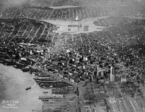 SEATTLE, 1924 aerial looking north over business district to Lake Union and Green Lake.